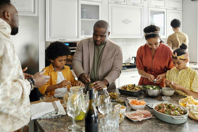 family-preparing-meal-together-in-the-kitchen.jpg