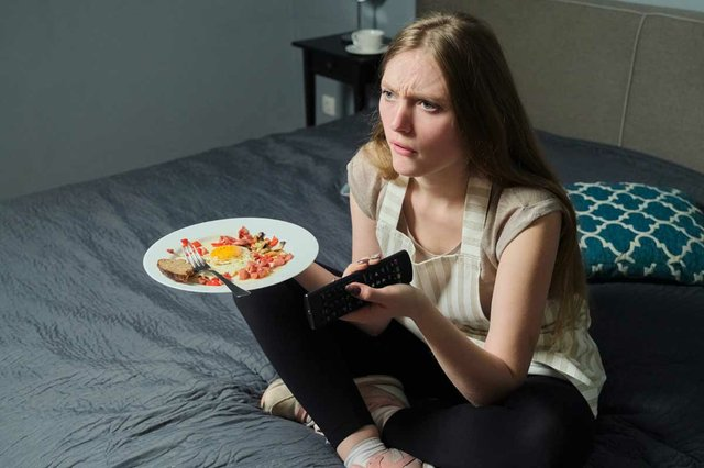 food-plate-hands-young-woman-watching-tv.jpg