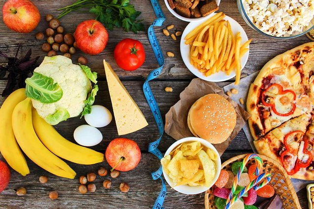 fast-food-healthy-food-old-wooden-table-concept-choosing-correct-nutrition-junk-eating-top.jpg