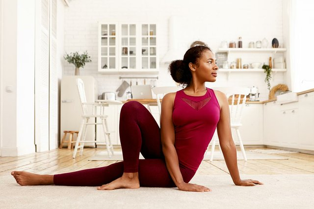 horizontal-image-sporty-stylish-young-woman-sports-clothes-practicing-yoga-sitting-mat-with-one-knee-bent-turning-head-healthy-lifestyle-wellbeing.jpg