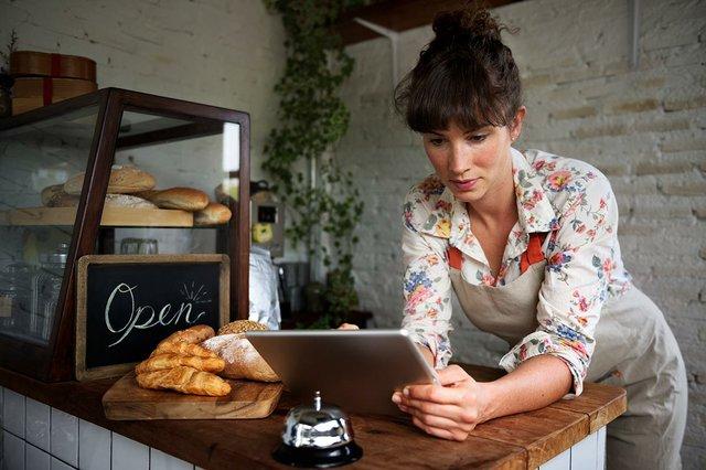 woman-working-using-digital-tablet.jpg