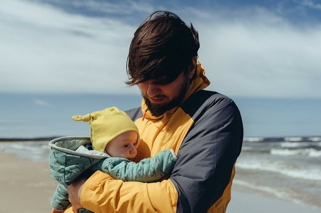 father-holds-his-baby-at-the-beach.jpg