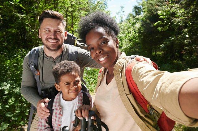 portrait-happy-family-three-making-selfie-portrait-mobile-phone-during-hike.jpg