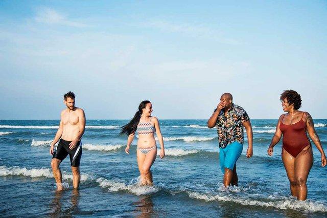 group-cheerful-friends-beach-walking.jpg