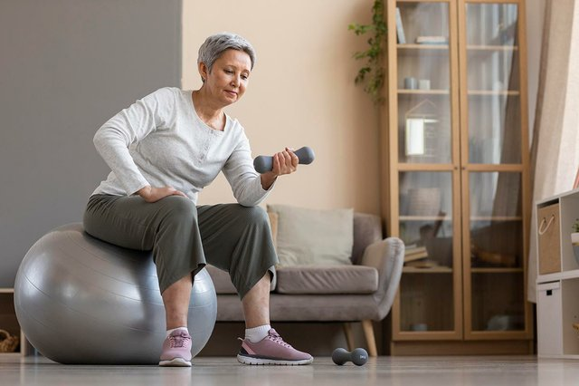 senior-woman-training-at-home-with-weights.jpg