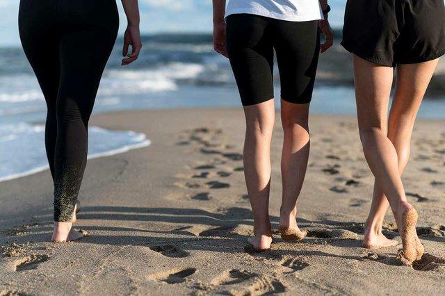 close-up-feet-women-walking-shore.jpg