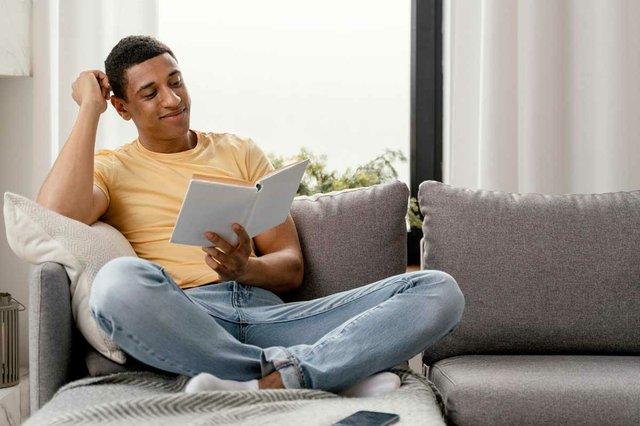 portrait-man-relaxing-home-reading-on-sofa.jpg