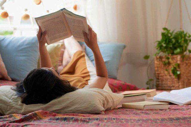 brunette-lying-bed-reading-book.jpg