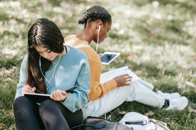 students-studying-together-in-the-park.jpg