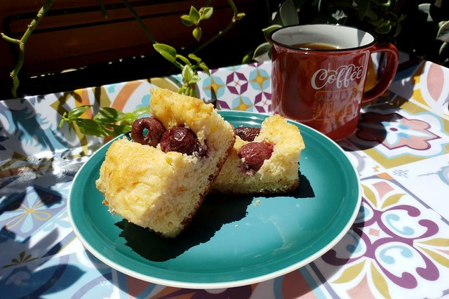 cherry-coca-on-blue-plate-and-cup-of-coffee.jpg