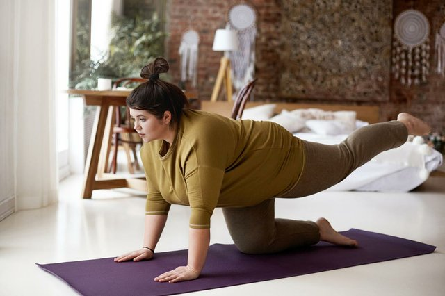 sports-activity-fitness-concept-indoor-image-concentrated-self-determined-young-plus-size-woman-leggings-t-shirt-exercising-mat-lifting-one-leg-hold-balance.jpg