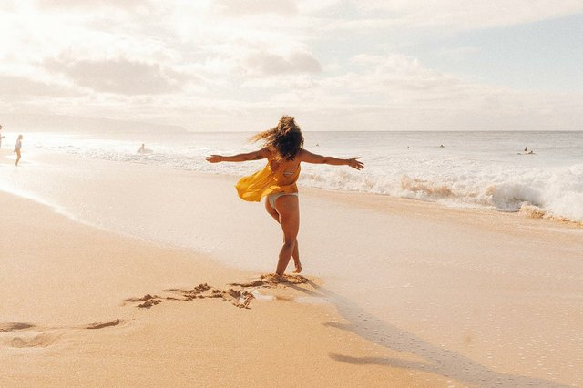 happy-woman-dancing-on-the-beach.jpg