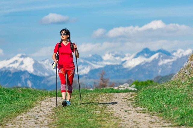 woman-hiking-on-mountain-road.jpg