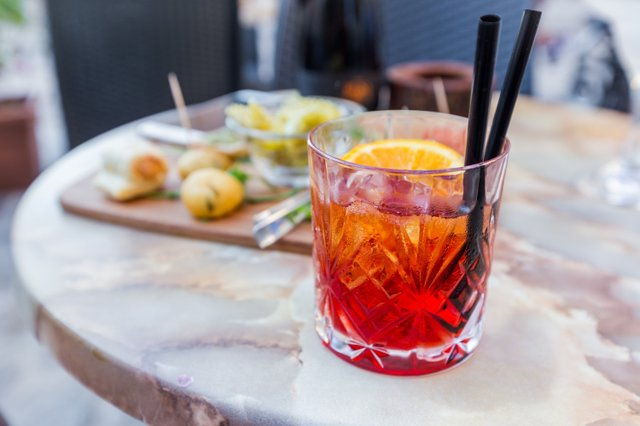 mezcal-negroni-cocktail-italian-aperitivo-table-open-area-restaurant.jpg