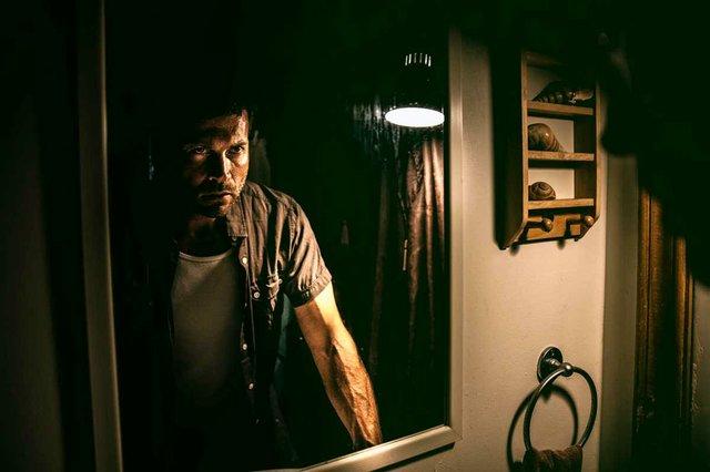 man-looking-in-bathroom-mirror.jpg