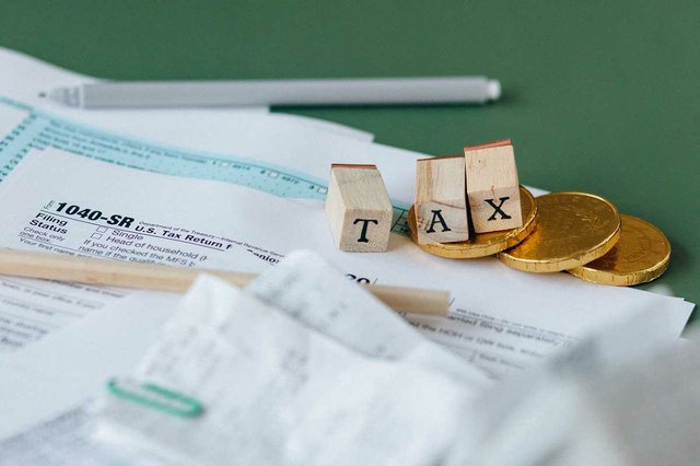 tax-forms-with-pencil-and-wood-blocks.jpg