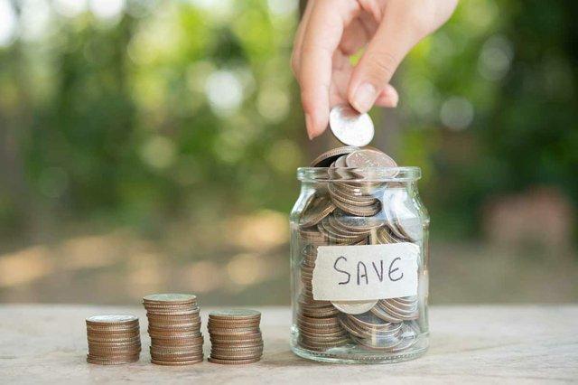 saving-money-concept-hand-putting-money-coin-stack-growing-business-arrange-coins-into-jar.jpg