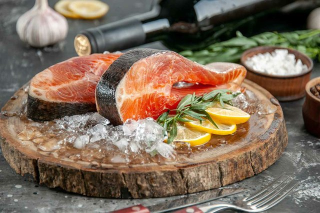 raw-fish-slices-with-lemon-slices-ice-grey-barbecue-food-meat-photo-seafood-dish-meal-color.jpg