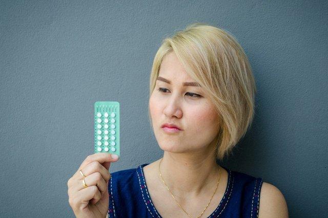 woman-holding-birth-control-pill.jpg