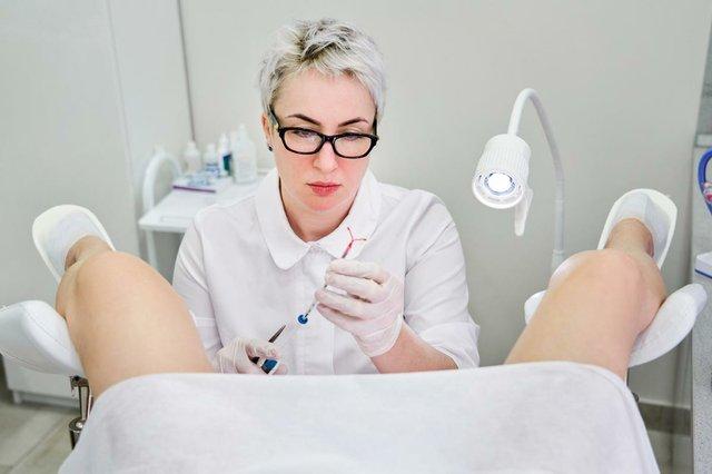 gynecologist-holding-iud-birth-control-device-patient.jpg