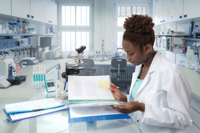 scientist-reading-laboratory-journal-research-facility.jpg
