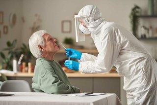 man-coronavirus-test-with-doctor-protective-suit-taking-analysis-home.jpg