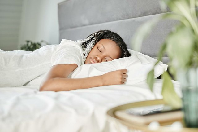 young-woman-sleeping-white-bed-sheets-morning.jpg