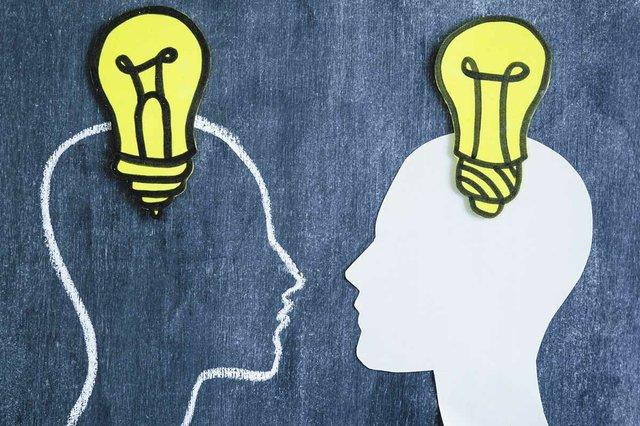 yellow-light-bulb-head-outline-white-paper-chalkboard.jpg