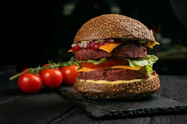 burger-with-vegan-meat-vegetables-sprinkled-with-sesame-seeds.jpg