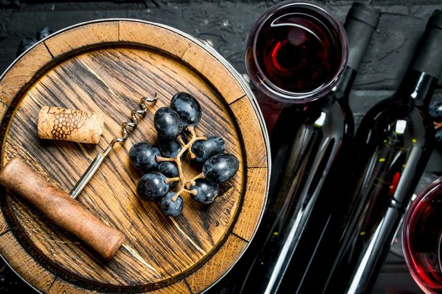wine-red-wine-with-grapes-old-barrel-rustic.jpg
