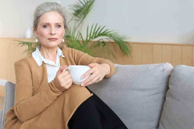 woman-resting-comfortable-sofa-drink-coffee-tea-looking-away-relaxing-cozy-couch-home-enjoy-hot-beverage.jpg