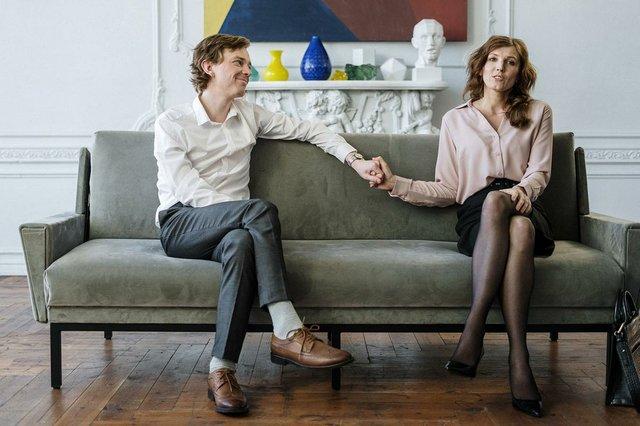 coupple-holding-hands-on-sofa.jpg