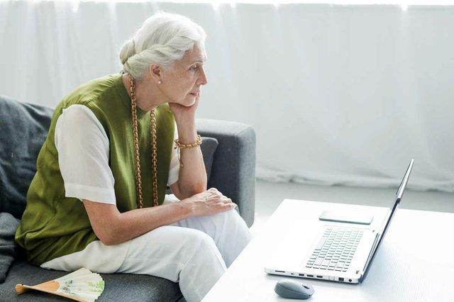 senior-woman-sitting-looking-laptop.jpg