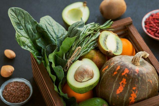 healthy-food-wooden-box-fruit-vegetables-seeds-superfood-leaf-vegetable-black-background.jpg