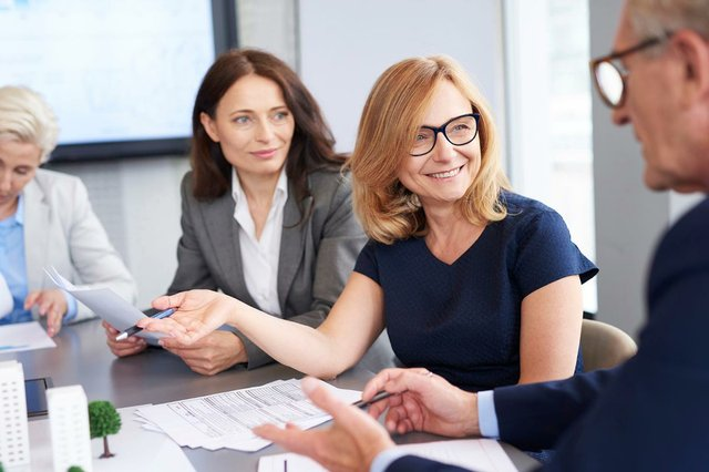 business-woman-presents-new-solutions.jpg
