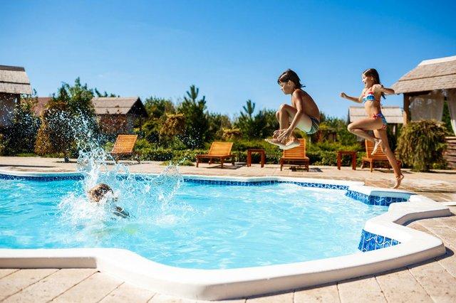 children-rejoicing-jumping-swimming-pool.jpg