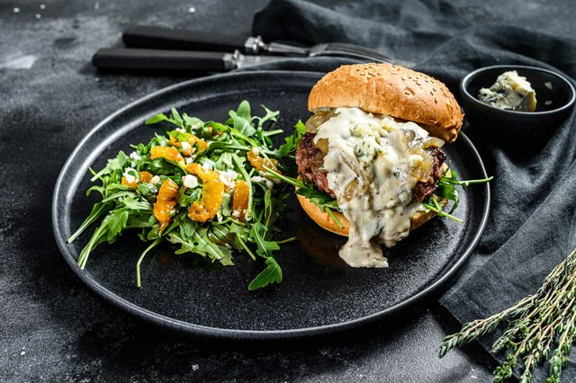 burgers-with-blue-cheese-bacon-marbled-beef-onion-marmalade-side-dish-salad-with-arugula-oranges.jpg