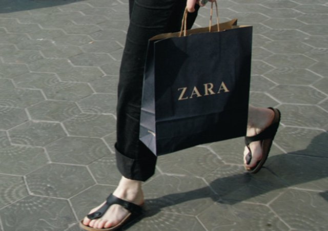 Girl carrying Zara shopping bag