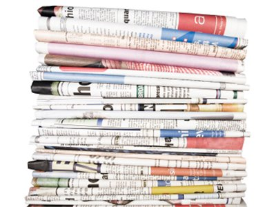 Stack of newspapers home