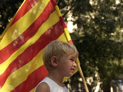 Child carrying Catalan flag Home