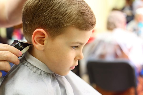 Little boy having his hair cut